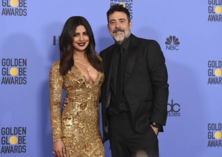 Priyanka Chopra, left, and Jeffrey Dean Morgan pose in the press room at the 74th annual Golden Globe Awards at the Beverly Hilton Hotel on Sunday, Jan. 8, 2017, in Beverly Hills, Calif. (Photo by Jordan Strauss/Invision/AP)