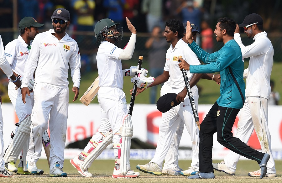 Bangladesh captain Mushfiqur Rahim (C) and teammates celebrate their victory over Sri Lanka by four wickets on the fifth and final day of the second and final Test cricket match between Sri Lanka and Bangladesh at The P. Sara Oval Cricket Stadium in Colombo on March 19, 2017. / AFP PHOTO / Ishara S. KODIKARA (Photo credit should read ISHARA S. KODIKARA/AFP/Getty Images)