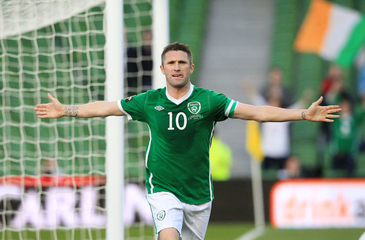 Republic of Ireland's Robbie Keane celebrates his goal against Northern Ireland with teammates during an international friendly football match at the Aviva Stadium in Dublin on May 24, 2011. AFP PHOTO/ PETER MUHLY (Photo credit should read PETER MUHLY/AFP/Getty Images)